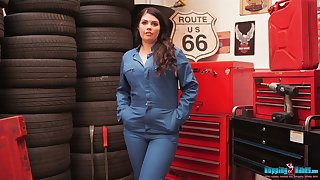 Lustful chick with juicy boobs and ass Kylie K gets naked in the tire shop