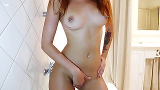 Smoking hot redhead Agatha teases her wet pussy right in the shower