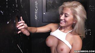 Striking MILF Cristi Ann sucks a throbbing peen through a gloryhole