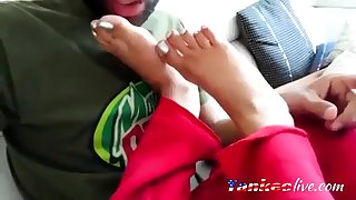 Sucking her appealing indian toes