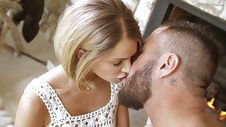 Tanned brunette in white Emma Hix gives a sensual blowjob and gets her slit banged