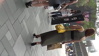 Black Stilettos Short Yellow Skirt Chinese model candid